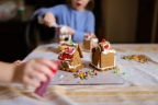 Decorating Gingerbread Houses.